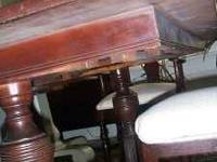 Mahogany, double pedestal Duncan Phyfe style dining