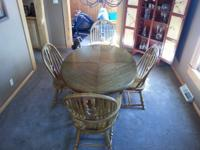 Dining room table and chairs with two leaf extensions.
