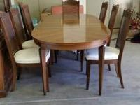 Table, 8 chairs, and 2 piece hutch. Great condition.
