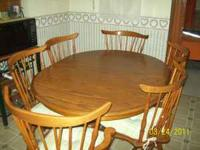 Double pedestal oak dining room table with six chairs