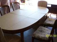 Oval pecan dining room table with six chairs, 2 leaves,