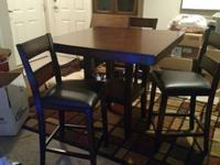Tall dining room table approx 4ftx4ft with shelf under.
