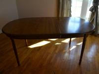 Nice oval-shaped dining room table and leaf with six