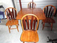 Very cute dining set for sale. Solid wood table and 4