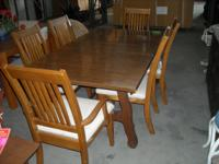 Dining set includes table w/leaf & 6 chairs and china