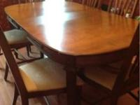This beautiful oak dining room set comes with a custom