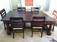 "Very nice hardwood dining table and chairs. 42"" wide"