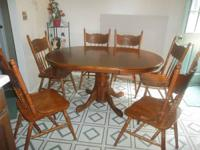 nice oak table with 6 chairs  great shape beautiful