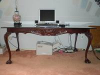 Up for sale is a glass and wood dining table. Measures