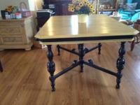 This vintage dining table is believed to be from the