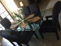 Beautiful heavy duty glass dining table with six black
