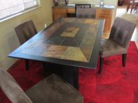 Wood and slate dining table with four chairs.  Perfect