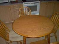 "oak dining table and 4 chairs 42"" round or 42"" x 55"""