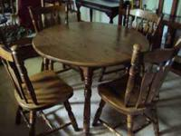 Dining table and 4 arrowback chairs for sale. the table