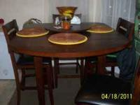 Chocolate square to round dining table with 4 high back