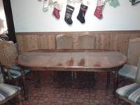 Solid wood table with two removable leafs. Six chairs,