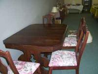 Beautiful dark wood table and chairs for sell. Asking