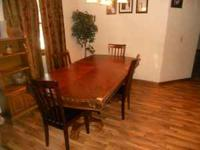 Dining table and four chairs Table is 7 ft long and has
