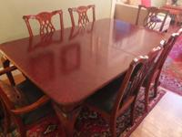 Elegant Dining Table and six chairsPolished wood,