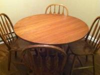 Oak table and four chairs.  Excellent condition.  Table