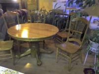 Description Dining table, with 2 leaves and 6 chairs.