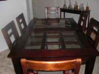 Dark Mahogany Wood Dining Set with Glass Insets. Seats