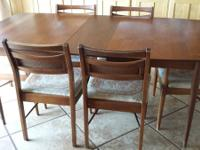Mid century dining table with 6 chairs. 2 captain's