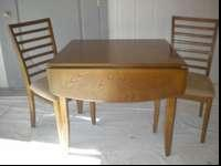 This dining table with 2 chairs is like new. The table