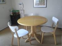 4 piece Dining set. Beautiful birch colored dining