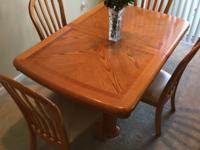 Oak veneer dining table and six chairs. Table is