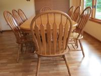 Solid oak table with 8 chairs, table extends to 8 feet