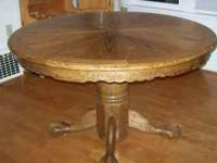 For sale: Round solid oak dining room table with claw