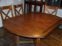 Beautiful dining table w/6 chairs. Measures 47 x 47.