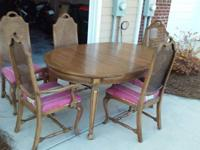 For sale is a great Regency style dining table with a