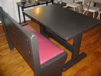 Beautiful black Dining Table with Red Leather Bench.