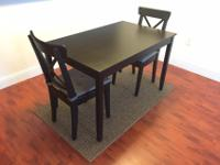 IKEA brand dining table with 2 chairs in excellent
