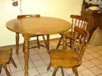 "Dining table on four legs 42"" Diameter 2 leaves 10x42 4"