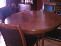 Round dark wood pedastal table with four chairs. $325.