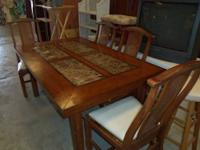DINING TABLE WITH 4 CHAIRS IN GOOD CONDITION ASKING