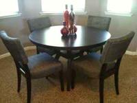 "New 48"" D round dining table with 4 side chairs. The"