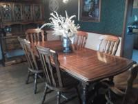 All wood dining room set with 6 chairs and 2 captain