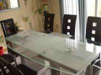 I got glass dining room table with leather chairs the