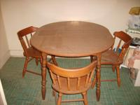 Dining table with three chairs in good