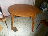 Really nice, solid round dining table. 42 inches