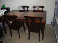 Nice Dining table and 4 chairs. Table has a glass top