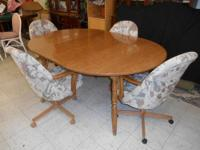 Dining Table with 4 Rolling Chairs and 2 Leaves , Table