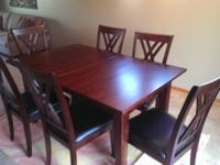 Dark hardwood dining room table that comes with 6
