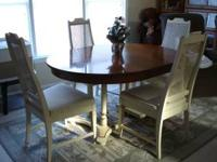 Sturdy table with four chairs. They all show signs of