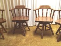 4 solid maple chairs with a swivel base so chair and
