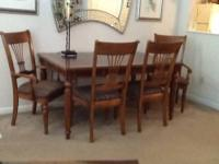 Dinning room table with 2 arm chairs & 2 side chairs.